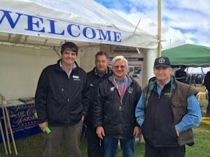 Shown, left to right, are Richard Kyte, Dairy NZ; Tau Ben-Una; Presbyterian Pastor; Dennis Schlagel, FCFI Executive Director; John Ranstead, Presbyterian Family Worker. Each man has been involved in the prayer, planning, and execution of the plan to be part of the Southern Field Days exhibit.